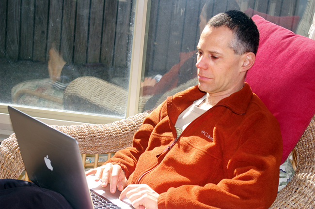 Steve Caplan at his laptop