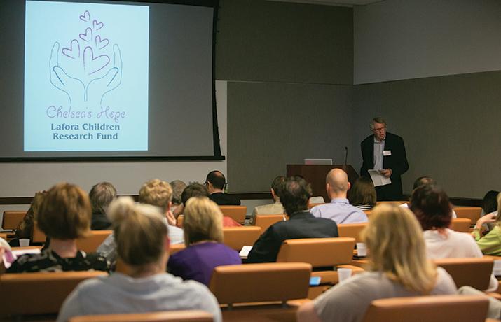Biochemist Jack Dixon gives a talk at the Lafora disease meeting.