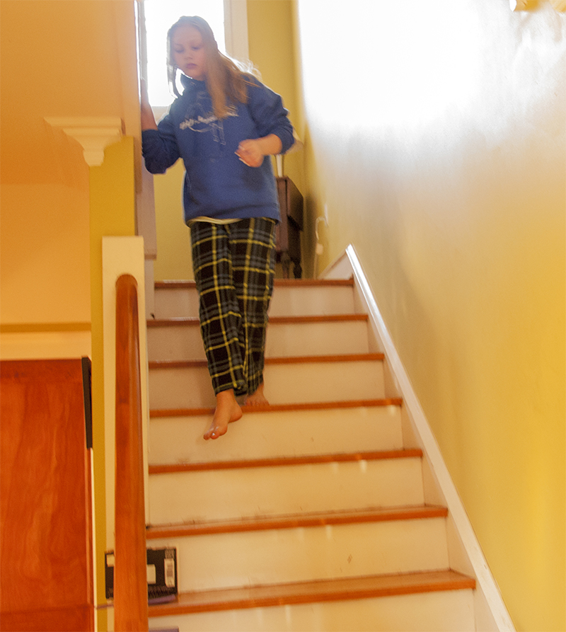 Lizzie makes her way down the stairs