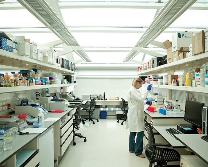 A Van Andel Institute Graduate School student works in a lab.