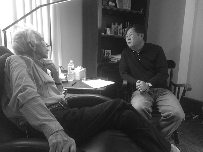 Tom August talks with Johns Hopkins colleague Yadong Wei